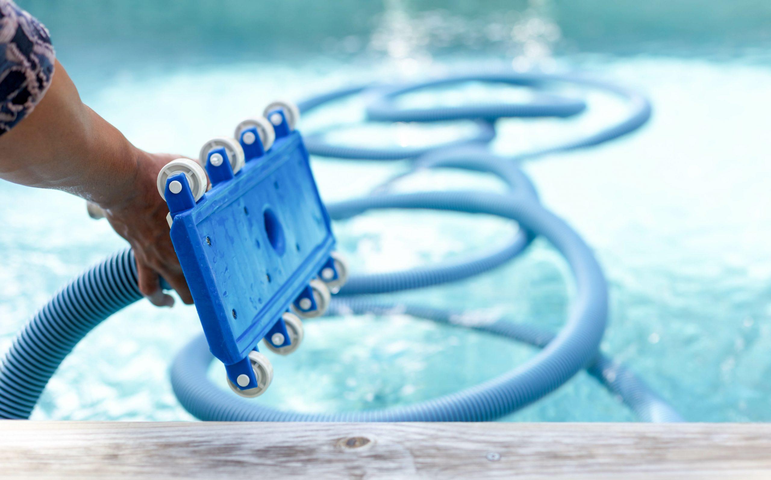 Pool cleaner being held above pool
